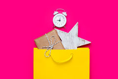 Cute gift, alarm clock and star shaped toy in beautiful yellow s Royalty Free Stock Photo