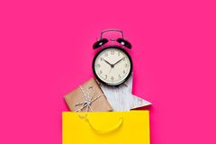 Cute gift, alarm clock and star shaped toy in beautiful yellow s Stock Photo