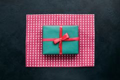 Cute gift for beloved people on dark background. Bright present wrapping. great surprise for birthday, fathers day, valentines day, new year, christmas Stock Photos