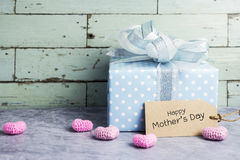 Cute gift box with happy mothers day message on brown paper tag Royalty Free Stock Photography