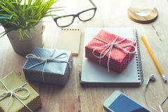 Cute gift box presents on worktable background.For christmas Royalty Free Stock Photography