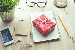 Cute gift box presents on worktable background.For christmas Royalty Free Stock Images