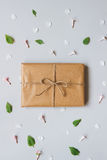 Cute gift box wrapped with craft paper top view. Gift for any ho Royalty Free Stock Images