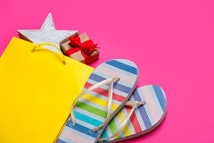 Cute gift and star shaped toy in beautiful yellow shopping bag a Royalty Free Stock Photography