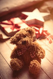 Cute gift, star shaped toy, teddy bear and things for wrapping o royalty free stock photography