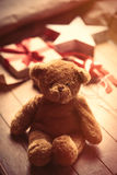 Cute gift, star shaped toy, teddy bear and things for wrapping o stock photography