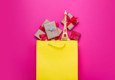Cute gifts and beautiful eiffel tower shaped toy in shopping bag Stock Image