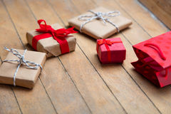Cute gifts and cool red shopping bag on the wonderful brown wood Stock Photo