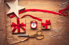 Cute gifts, star shaped toy, alarm clock and things for wrapping Stock Photo