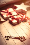 Cute gifts, star shaped toy, golden key and things for wrapping Stock Photo