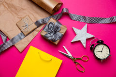 Cute gifts, star shaped toy, shopping bag, alarm clock and thing Royalty Free Stock Images