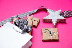 Cute gifts, star shaped toy, shopping bag and black dotted ribbo Royalty Free Stock Images