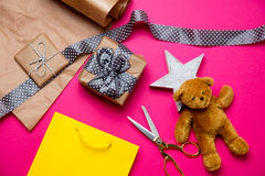 Cute gifts, star shaped toy, shopping bag, teddy bear and things Stock Photo