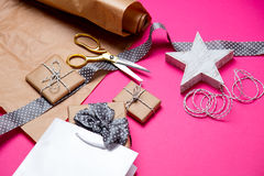 Cute gifts, star shaped toy, shopping bag and things for wrappin Stock Photos