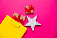 Cute gifts, star shaped toy and shopping bag on the wonderful pi Royalty Free Stock Photography