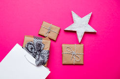Cute gifts, star shaped toy and shopping bag on the wonderful pi Stock Photography