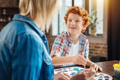 Cute ginger boy smiling broadly while looking at grandmother Stock Images