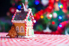 Cute gingerbread cookie and candy ginger house Royalty Free Stock Photo