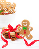 Cute Gingerbread cookies. Cute Christmas gingerbread cookies on white with bowl. Some cookies tied with red ribbon to make a delicious gift Royalty Free Stock Photography