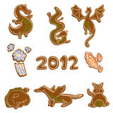 Cute Gingerbread dragons. Set of cute gingerbread dragon cookies for the year of 2012 Royalty Free Stock Images