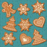 Cute gingerbread elements on knitted background stock illustration