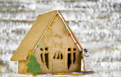 Cute gingerbread house on silver background Stock Photo