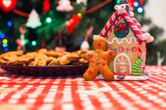 Cute gingerbread man in front of his candy ginger Royalty Free Stock Photos