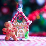 Cute gingerbread man in front of his candy ginger Stock Photography