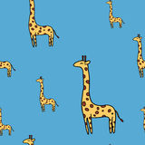 Cute giraffe seamless vector pattern on blue Royalty Free Stock Photography