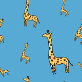 Cute giraffe seamless vector pattern on blue Stock Images