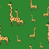 Cute giraffe seamless vector pattern on green Stock Photo
