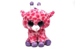 A cute giraffe soft toy with pink spots. A photo taken on a cute giraffe soft toy with pink spots against a white backdrop stock photography