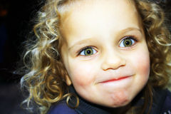 Cute girl. Little sweet surprised girl with curly hair Royalty Free Stock Image