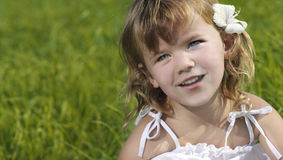 Cute girl. Portrait on green grass Royalty Free Stock Image