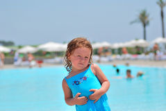 Cute Girl. In front of the pool Stock Images