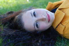 Cute Girl. A girl is laying on grass Stock Photos