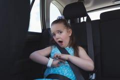 Cute girl adjusting smart watch Royalty Free Stock Image