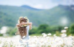 Cute girl admires nature summer mountain meadow Stock Photos