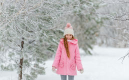 Girl in pink coat enjoying being outside Royalty Free Stock Photo