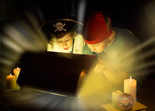 Cute girl and adventurous boy found a treasures. Happy young pirates. Stock Photos
