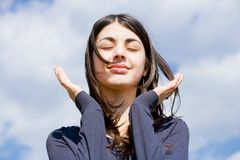 Cute girl against blue sky Royalty Free Stock Photo