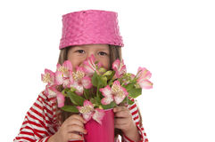 Cute girl at the age of five with pink flowers Stock Photos