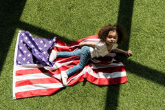 Cute girl with american flag royalty free stock image