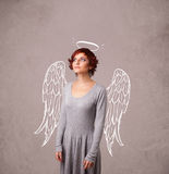 Cute girl with angel illustrated wings Royalty Free Stock Photos