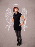 Cute girl with angel illustrated wings Royalty Free Stock Photography