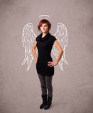 Cute girl with angel illustrated wings Royalty Free Stock Photo