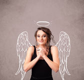 Cute girl with angel illustrated wings Royalty Free Stock Image