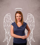 Cute girl with angel illustrated wings Stock Image