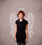 Cute girl with angel illustrated wings Stock Photo