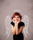 Cute girl with angel illustrated wings Stock Photography